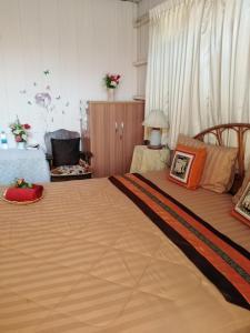 Ein Bett oder Betten in einem Zimmer der Unterkunft Bankullar