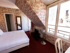 Letto o letti in una camera di Regyn's Montmartre