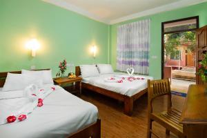Cama o camas de una habitación en View Point Guest House