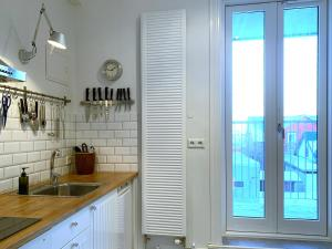 A kitchen or kitchenette at Nest Apartments