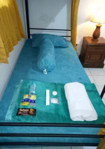 A bed or beds in a room at Sky Hotel Sanjaya