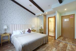 Кровать или кровати в номере Мини-отель Морошка