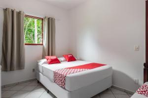 A bed or beds in a room at OYO Pousada Tia Léo Campinas