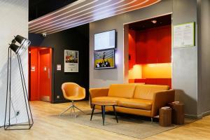 Coin salon dans l'établissement Ibis Styles Paris Massena Olympiades