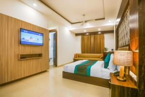 A television and/or entertainment center at Hotel Almati Inn at Delhi Airport