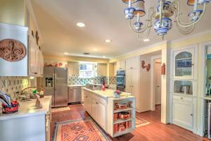 A kitchen or kitchenette at Stately Dallas Home with Pool, Patio & Entertainment!