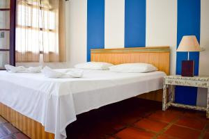 A bed or beds in a room at Pousada Maanaim II