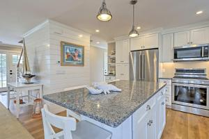 A kitchen or kitchenette at Luxurious West Yarmouth House with Backyard and Bay Views