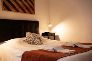 Uma cama ou camas num quarto em Burgos Guest House