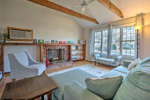 A seating area at Cozy Yarmouth Home - Walk to Colonial Acres Beach!