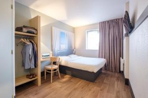 Un ou plusieurs lits superposés dans un hébergement de l'établissement B&B Hôtel Dunkerque Centre Gare