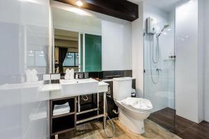 A bathroom at The Nice Krabi Hotel