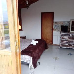 Cama ou camas em um quarto em Pousada Sonho do Vale
