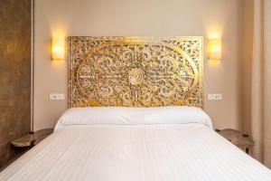 Cama o camas de una habitación en Apartamentos SEVILLA ESTE