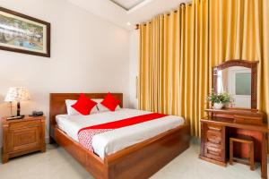 A bed or beds in a room at Sea Beach Hotel
