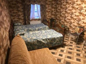 A bed or beds in a room at Маргошин Дом