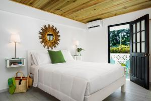 A bed or beds in a room at White Sands Negril