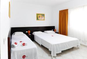 Cama ou camas em um quarto em Nautilus Aparthotel