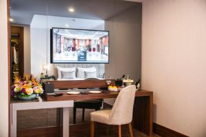 A television and/or entertainment center at Vogue Hotel Supreme Istanbul