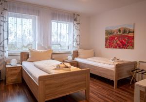 Ein Bett oder Betten in einem Zimmer der Unterkunft Hotel Bouzid - Laatzen
