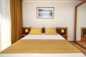 A bed or beds in a room at Orbi Palace Hotel Official