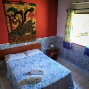 A bed or beds in a room at Village Miramar