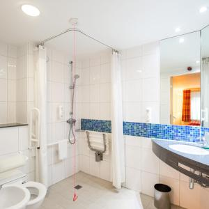 A bathroom at Holiday Inn Express London Golders Green, an IHG Hotel