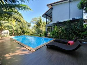 The swimming pool at or close to Lanta Thip House