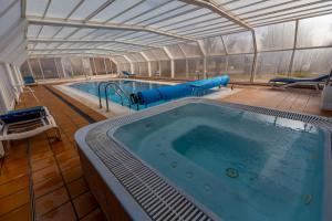 The swimming pool at or near FONDUQ Hotel Rubielos