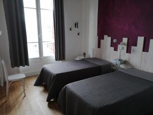 A bed or beds in a room at Résidence du Lac