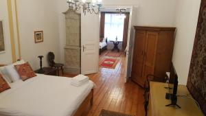 A bed or beds in a room at Casa Mador