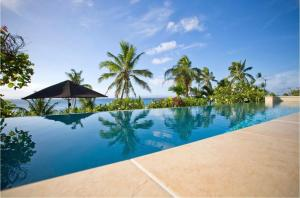 The swimming pool at or near Taveuni Palms Resort