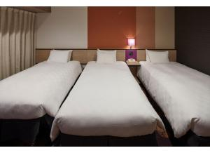 A bed or beds in a room at Sunshine City Prince Hotel Ikebukuro
