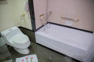 A bathroom at Regal Palace Hotel