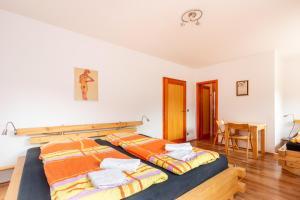 A bed or beds in a room at Ubytování Bezchlebovi