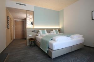 Ein Bett oder Betten in einem Zimmer der Unterkunft Donau Lodge
