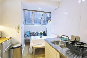 A kitchen or kitchenette at Covent Garden Suites