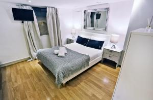 A bed or beds in a room at Covent Garden Suites