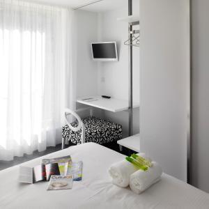 Cama o camas de una habitación en Moure Hotel