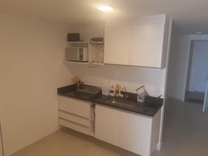 A kitchen or kitchenette at Orla 22 Búzios