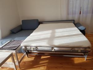 Ein Bett oder Betten in einem Zimmer der Unterkunft Apartment Eichetwald