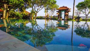 The swimming pool at or near The Mahalani - All-Inclusive Oceanfront Villa