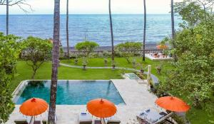 A view of the pool at The Mahalani - All-Inclusive Oceanfront Villa or nearby