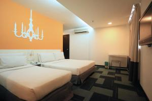 A bed or beds in a room at Citrus Hotel Johor Bahru by Compass Hospitality