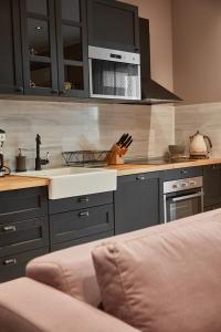 O bucătărie sau chicinetă la Apartamente Amelie