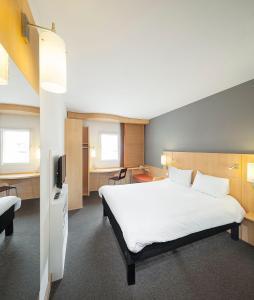 Кровать или кровати в номере Ibis Praha Old Town