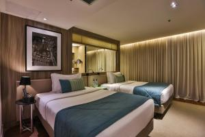 A bed or beds in a room at Radisson Vila Olimpia
