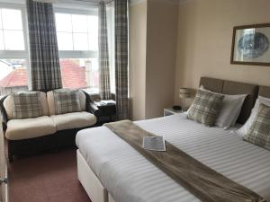 A bed or beds in a room at Bude Haven Guest House