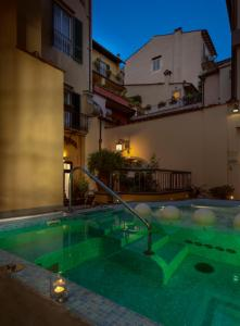 The swimming pool at or near Rivoli Boutique Hotel