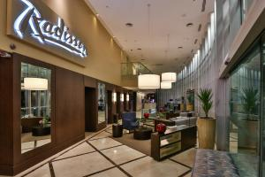 The lobby or reception area at Radisson Vila Olimpia